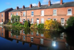 Living canalside (Rileythelifeof) Tags: blue houses england sunlight reflection english home water canal cheshire terrace chester sunburst waterside canalside