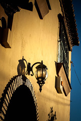 Andalucian Lantern (k009034) Tags: old travel light shadow house building window lamp beautiful wall canon photography eos 350d spain balcony retro lantern rebelxt oldbuilding fuengirola beautifulearth