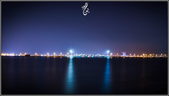 Bridge AL-Muharraq (WorD4AdobE) Tags: city longexposure bridge building beach landscape cityscapes astro nightsky