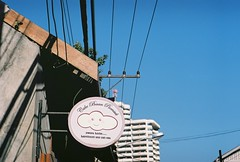 cloudy blue (lonely radio) Tags: sky signs film clouds buildings thailand shadows rangefinder wires chiangmai leicam6 000169 leicasummicron50mmf2collapsibleltm cakebaanpiemsuk