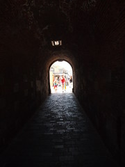 Gibraltar, British Overseas Territory (lady black) Tags: light sea people rock wall dark spain mediterranean arch tunnel massive enter gibraltar thick iberianpeninsula britishoverseasterritory