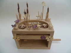 Perfect Pond 201 (Wanda Sowry) Tags: wood flowers fish colour water yellow reeds garden toy handle moving wooden movement pond lily purple natural parts cam lilies frogs cog mechanism automata automaton yellowflagiris bullreed