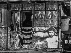 Sexy advertisement on home exterior (FotoGrazio) Tags: poverty shirtless man sexy male home window face sex advertising poster model apartment philippines poor billboard advertisement clothes laundry stare sexual pinoy mindanao squatter dwelling sells advertise sexsells clothesdrying davaocity sexinadvertising hangingouttodry contrastblackandwhite hangingclothing fotograzio waynegrazio rattanwalls