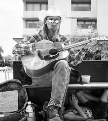 Anthony n Son (mkc609) Tags: street portrait urban blackandwhite bw 6x6 film austin mediumformat blackwhite cowboy kodak guitar candid tx streetphotography portra400 501c hasselbad