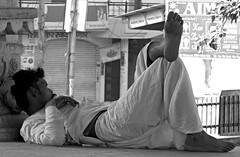 bundi 2015 (gerben more) Tags: india man monochrome blackwhite moustache barefoot resting rajasthan bundi