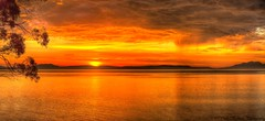 Sunrise on the Great Oyster Bay (pano) (myshutterworld) Tags: sunset panorama moon beach sunshine swansea clouds sunrise landscape nightscape pano under australia down moonlit moonrise tasmania tassie hdr chalets freycinet