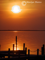Orange Sunset Over the Sound (moelynphotos) Tags: sunset setting sun dusk orange color silhouetted dock reflections glow tranquil vertical nobody outer banks northcarolina southern usa barrier island currituck sound evening romantic moelynphotos