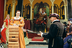 Attempting to Master This Trick - Shot on Film (Robb Wilson) Tags: renaissance irwindale renaissancefaire 2016renaissancepleasurefaire games familygathering woodenblocks swords smilingladies tudoreraclothing