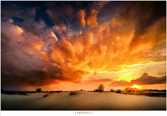 Surealistic sunset (nandOOnline) Tags: colors photoshop zonsondergang saturated fuji nederland wolken saturation fujifilm unreal mierlo regenwolken regenbui nbrabant xpro2