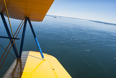 Kat's view from up in a 1941 Stearman biplane - Rockland / Owls Head, Maine (Jonmikel & Kat-YSNP) Tags: ocean blue trees summer me yellow flying flight wing maine shy biplane rockland owlshead owlsheadtransportationmuseum 1941stearmanbiplane