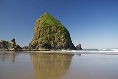 Haystack Rock (MSPeters) Tags: ocean park travel blue sea sky panorama seascape reflection green tourism beach nature water rock oregon portland landscape coast amazing sand surf waves state pacific northwest hiking tide scenic peaceful wave adventure formation shore haystack cannon coastline ecola ecosystem