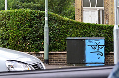 Glum Box, the view from the road (Di's Free Range Fotos) Tags: road uk england face car graffiti driving driveby greenbox glumface electricityconductionbox