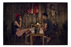 Thai couple in red with shisha (vicimck) Tags: red girl bar thailand cafe san couple shisha drink bangkok thai share kao banglampoo