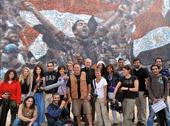 The cast and crew in front of a revolutionary mural at the American University in Cairo.