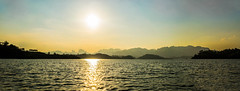 Sunset over Chiew Lan lake (Julie. D) Tags: sunset panorama lake mountains nature landscape thailand lac paysage montagnes thailande couchdesoleil khaosok autopano nikond3100 chiewlanlake chiewlan