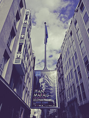 ... (Gabriel M.A.) Tags: blue windows paris france clouds buildings poster pub fuji flag rangefinder cropped toned x20 affiche crumpled 2x3 4x6 jeanmarais