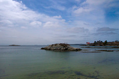 The Little Island by the Lighthouse (SunnyDazzled) Tags: blue light sea sky lighthouse seascape history beach clouds island bay coast maine coastal legends southport hendricks atlandtic hendrickshead