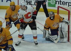 Action Around The Net (roopez123) Tags: ice sports hockey yellow gold nhl losangeles icehockey kings uniforms puck jerseys southerncalifornia sportsaction staples throwback calgaryflames staplescenter lakings losangeleskings jersies jonathanquick drewdoughty