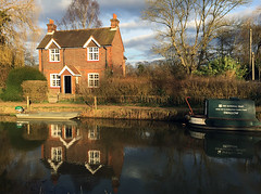 The Golden Hour at Lock Keepers Cottage (pg tips2) Tags: sunset reflection water reflections march canal spring still sundown cottage peaceful surrey guildford tranquil navigation stcatherines narrowboat godalming waterway towpath goldenhour wey softlight wardenshouse weygodalmingnavigation