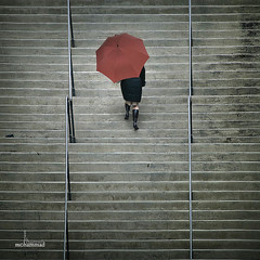 The Red Umbrella (mhd.hamwi) Tags: winter red woman usa chicago cold up rain lady stairs umbrella illinois nikon downtown outdoor rainy   theredumbrella nikond5000 mhdhamwi mohammadhamwi