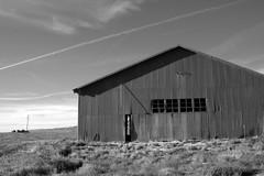 Jets Overhead (nedlugr) Tags: california ca door windows blackandwhite bw usa barn shadows desert warehouse corrugated carrizoplain omot
