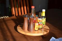 Sunlit condiments (ssfaulkn) Tags: salt hotsauce beesting lazysusan datil peppr