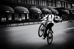 Hi Ho Silver ... Away (Ian Livesey) Tags: harrods blackwhite cycle cyclist uk england road streetphotography