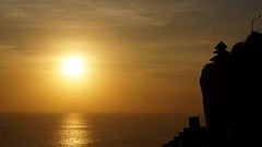 Orange sunset in Uluwatu (gabrielafundora) Tags: ocean travel light sunset sea bali orange sun reflection silhouette indonesia landscape temple asia landmark cielo uluwatu aire