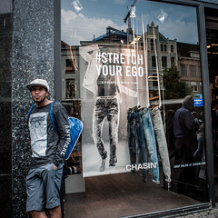 Stretch your ego (Utrecht) (PaulHoo) Tags: street boy people man holland reflection guy window netherlands glass fashion shop youth ego square person nikon utrecht candid citylife streetphotography streetportrait streetlife squareformat lightroom 2016 streetcandid d700