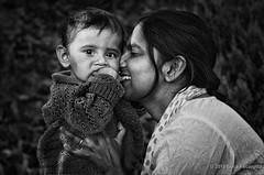 Mum's pride (Feca Luca) Tags: portrait blackwhite people children woman family donna bimbi outdoor india hindu asia nikon ritratto