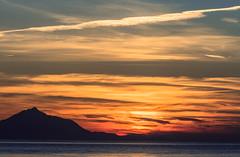 Sky on fire - A Mount Athos Sunset - View from Blue Waves Cafe-Bar - Myrina on Lemnos (Cropped) (Olympus OMD EM5II & mZuiko 40-150mm f2.8 Pro Zoom) (1 of 1) (markdbaynham) Tags: sunset colour clouds island greek view zoom hellas evil olympus mount greece grecia pro gr zuiko omd athos csc oly mz limnos hellenic m43 zd mft lemnos myrina em5 mirrorless micro43 microfourthird micro43rd mzuiko m43rd em5ii zuikolic