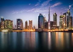 Burj Khalifa Blue Hour Illumination (explored) (hpd-fotografy) Tags: street city longexposure nightphotography reflection water skyline architecture night skyscraper neon dubai cityscape traffic uae center future bluehour businessbay burjkhalifa