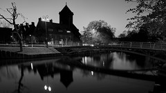 Close to home (McQuaide Photography) Tags: old city longexposure nightphotography bridge light blackandwhite bw house holland reflection building history church haarlem netherlands monochrome dutch architecture night zeiss outside mono licht canal blackwhite europe nacht outdoor widescreen sony traditional tripod nederland wideangle oldbuildings panoramic historic brug fullframe alpha huis residential 169 kerk oud stad authentic manfrotto noordholland gebouw gracht c1 huizen wideanglelens 1635mm northholland groothoek phaseone variotessar captureone mirrorless sonyzeiss kinderhuissingel mcquaidephotography a7rii ilce7rm2 captureonepro9