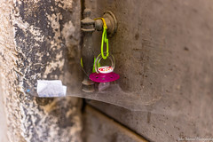 Random pacifier in the Jewish Ghetto (JollyGreenJohn) Tags: old travel venice italy baby art texture photography spider photo europe flickr mood foto fotograf photos random web spiderweb odd dslr popular ghetto pacifier 500px