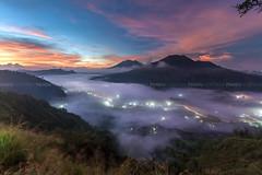 Light Trails Beneath the Clouds - Bali Photography Tour (Pandu Adnyana Photography Tour) Tags: travel bali sunrise indonesia landscape tour hill guide batur pinggan balitravelphotography baliphotographytour baliphotographyguide balilandscapetour balilandscapephotography
