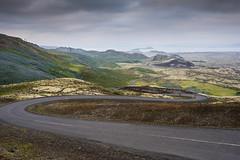DSC07691 (Gumundur Rbert) Tags: sky white mountain black 35mm cycling climb iceland cloudy f14 sony climbing rolf prima reykjavk sland ares a7ii pansonic samyang reihjl rokinon