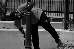 Thirsty (Daniel Nebreda Lucea) Tags: people gente drink beber man hombre thirsty sediento black white blanco negro monochrome street calle hot calor fontaine fuente urban urbano city ciudad