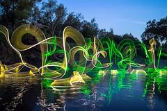 Tapeworms dancing on the river. (Nikolas Fotos) Tags: longexposure nightphotography lightpainting reflection nightscape nightshot nightphoto lichtmalerei lightart llightpainting lightpaintingphotography