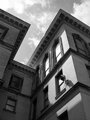 Beneath the Eaves (tim.perdue) Tags: school windows roof columbus ohio urban bw white black brick abandoned wall high closed village decay junior eaves merion monochromebarrett