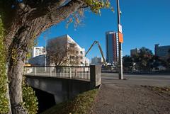 The Orange Sign (Jocey K) Tags: city bridge autumn trees newzealand christchurch sky signs architecture buildings reflections river shadows may demolition cranes vehicles nz cbd avon deconstruction avonriver manchesterst