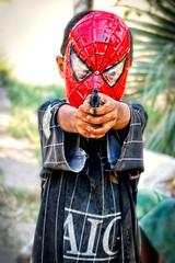 I shot you (Labjus) Tags: travel toy photo kid asia gun shot mask burma spiderman uomo jokes myanmar pistola childish maschera giochi ragno bambino giocattolo birmania infantili labjus