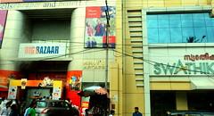 Shops @ Trivandrum, Kerala (nlkjasdf) Tags: street windows sky people india cars glass big south kerala shops bazaar avenue trivandrum malayalam thiruvananthapuram