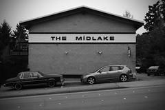The Midlake (KurtClark) Tags: blackandwhite building brick apartment retro mazda cinderblock vignette olds oldsmobile midlake ne8thstreet