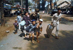 1968, Cholon, Saigon (tommy japan) Tags: road street family people house children parents store war asia southeastasia vietnamese asians tank many refugee victim father crowd group mother battle luggage vietnam vehicle males females casualty dwelling militaryvehicle escaping southvietnam southeastasians historicevent asianhistoricalevent northamericanhistoricalevent unitedstateshistoricalevent vietnamwar19591975 vietnamesehistoricalevent townscenes motorvehicle warvictim