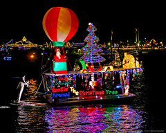 2013 Newport Beach Christmas Boat Parade 12.20.13 4 (Marcie Gonzalez) Tags: ocean california lighting county christmas xmas family decorations light orange holiday color reflection beach water colors sailboat canon reflections festive fun boats island photography lights coast boat holidays colorful december sailing ship bright yacht events ships families floating parades vessel twinkle parade sparkle celebration southern event celebrations newport boating coloring reflective bulbs yachts festivity gonzalez sailboats float balboa decor festivities celebrate brightness sparkling twinkling marcie lido stands costal decorated brights yearly marciegonzalez marciegonzalezphotography