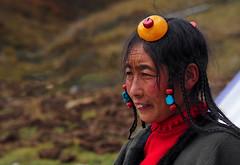 Tibetan Nomad woman, Tibet 2013 (reurinkjan) Tags: headdress prettywoman 2013 amberjewelry turquoisejewelry coraljewelry བོད་ལྗོངས། ©janreurink tibetanplateauབོད་མཐོ་སྒང་bötogang tibetབོད nomadicareaའབྲོག་པའི་ས tibetanchildrenབོད་ཕྲུགbötruk nomadསོག་ཡུལ་གྱི་འབྲོག་པsokyülgyindrokpa individualnoncollectivizednomadsཁེར་རྐྱང་འབྲོག་པkherkyangdrokpa womanསྐྱེས་དམན་kyemen བུད་མེདbümé beautifulwomanབུད་མེད་མཆོགbümemchok ladyfemalewomanམོmo མོ་སྐྱེསmokyé femalesམོ་རྣམསmonam khamཁམས།easterntibet nomadsའབྲོག་པ།brogpadrokpa lordofcattlenomadབ་ལང་དབང་ཕྱུག་balangdbangphyugbalangwangchuk ༢༠༡༣ khamཁམས་བོད khamsbodkhamwö dergeསྡེ་དགེ།county བུད་མེད་མཆོར་མོbüméchormo familystreasuredjewelry