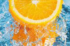fresh orange (The Daniel Plan) Tags: blue light summer food orange white cold color colour macro nature wet water closeup fruit waterfall spring juicy cool healthy aqua shot bright drink juice vibrant ripple background beverage wave nobody drop fresh falling clear part health slice bubble swirl citrus flowing concept splash peel refreshing freshness ripe refreshment splashing