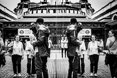 Raise Your Right Hand (Sean Batten) Tags: street city england people urban blackandwhite bw reflection london glass 35mm nikon df market unitedkingdom streetphotography tourists gb coventgarden cobbles londontransportmuseum