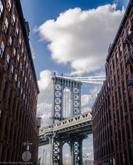 Manhattan Bridge, NYC - Dumbo (ravi_pardesi) Tags: nyc bridge sky urban usa newyork architecture brooklyn outdoor manhattan dumbo bridges bluesky serene urbanscape awesomeness