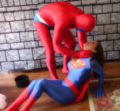 SuperWoman's trap.Still003 (1) (Spandxcomics) Tags: cosplay supergirl spandex superwoman superheroine
